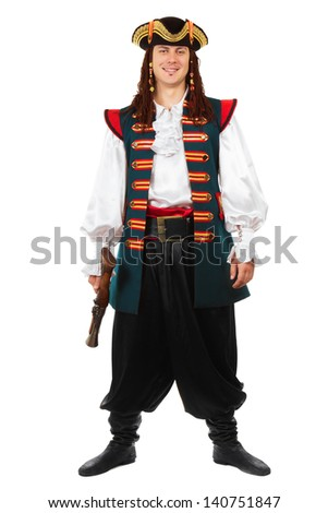 Smiling man posing in pirate costume with a pistol. Isolated on white  - stock photo