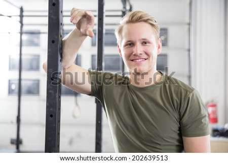 Smiling man rests in fitness gym center - stock photo