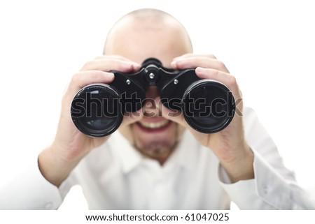 smiling man with binocular selective focus image - stock photo