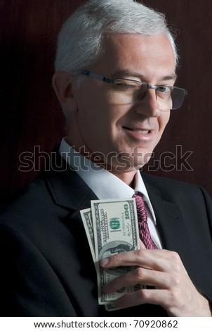 smiling man with dollars portrait - stock photo