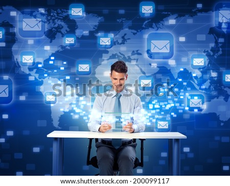 Smiling man with futuristic digital tablet, global communication with mail - stock photo