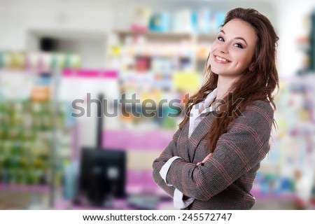 Smiling manager in suite over a blured background - stock photo