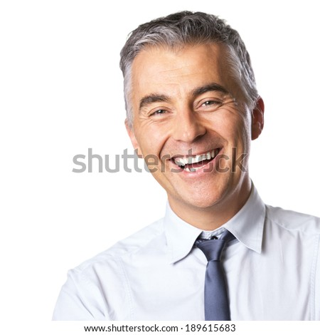 Smiling mature businessman in white shirt and tie looking at camera on white background. - stock photo