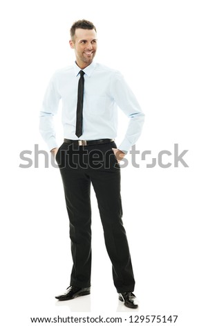 Smiling mature businessman standing - stock photo