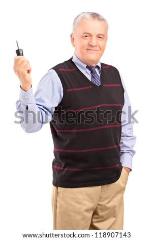 Smiling mature gentleman holding a car key isolated on white background - stock photo