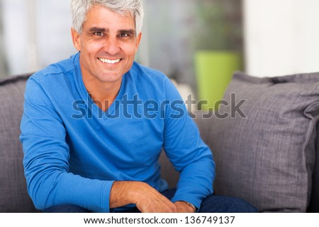 smiling mature man relaxing at home - stock photo