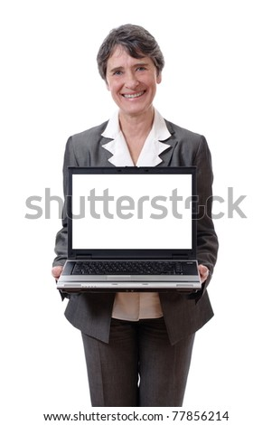 Smiling mature woman presenting laptop with empty screen isolated on white background - stock photo