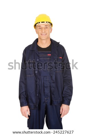 Smiling mature worker with hard hat. - stock photo