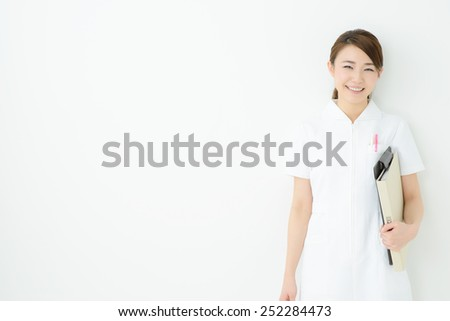 Smiling medical doctor or nurse. Isolated on white background - stock photo
