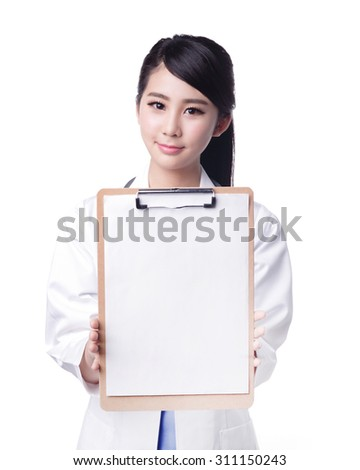Smiling medical doctor woman show copy space. Isolated over white background. asian - stock photo