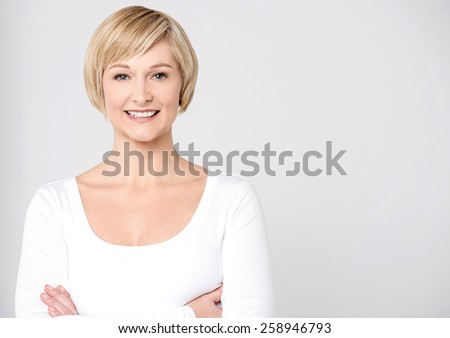 Smiling mid woman posing with folded arms - stock photo