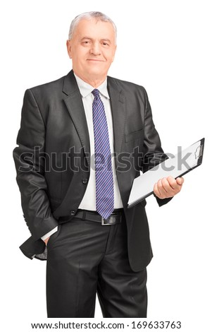 Smiling middle aged businessman holding clipboard, isolated on white background - stock photo