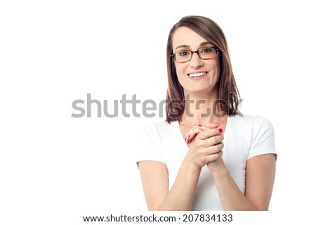 Smiling middle aged lady posing with clasped hands - stock photo