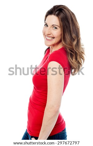 Smiling middle aged woman looking at camera - stock photo