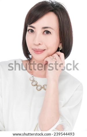 Smiling middle aged woman posing on white background - stock photo