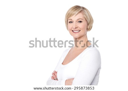Smiling middle aged woman with folded arms - stock photo