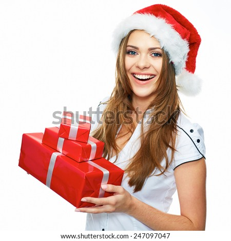 Smiling model posing in studio with gifts. Beautiful Santa Girl. Isolated white background. - stock photo