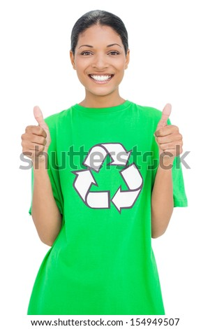 Smiling model wearing recycling tshirt giving thumbs up on white background - stock photo
