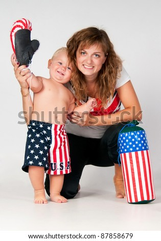 Smiling mom and son waving his hand on a white background - stock photo