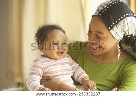 Smiling Mother and Daughter - stock photo