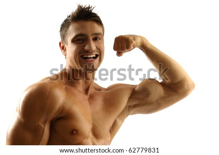 Smiling muscleman showing his muscles - stock photo