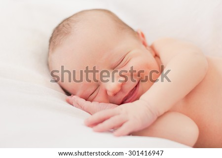 Smiling newborn baby boy - stock photo