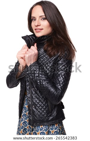 Smiling nice girl in dress with leather jacket. Isolated - stock photo