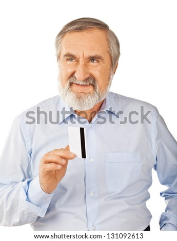 Smiling old man holding up a cash card Isolated on white background - stock photo