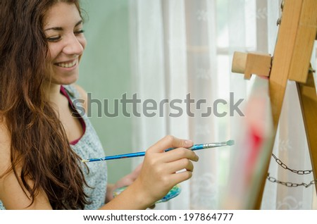 Smiling painter - stock photo
