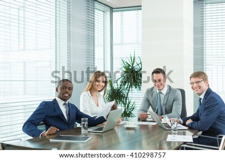 Smiling people at meeting in office - stock photo