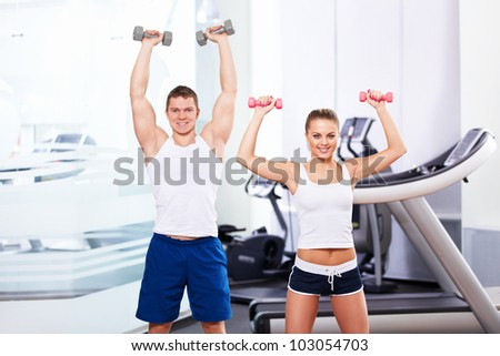 Smiling people in the gym - stock photo