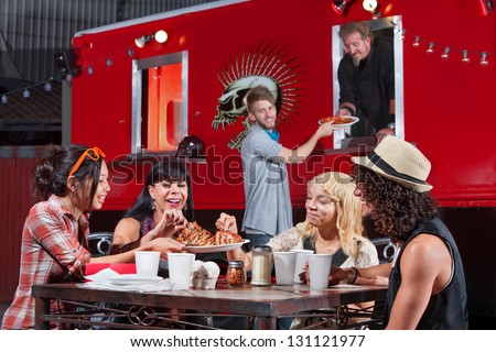 Smiling people sharing pizza and ordering food from canteen - stock photo