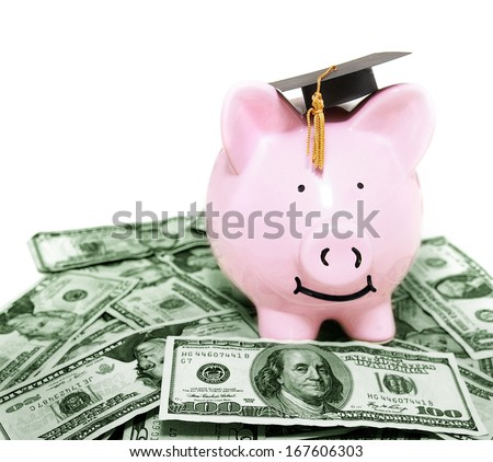 smiling piggy bank with graduation cap, on cash - stock photo