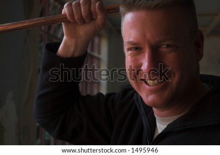 Smiling plumber construction worker - stock photo