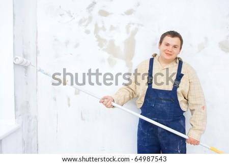 Smiling portrait of student painter - stock photo