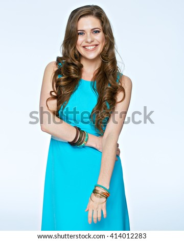 Smiling positive emotional woman standing against white background. Evening dress. - stock photo