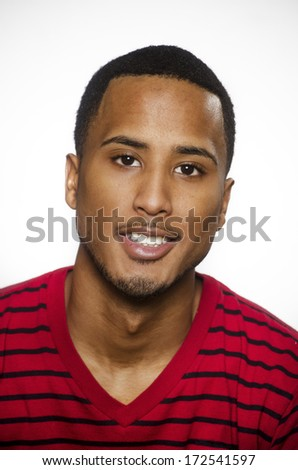 Smiling positive handsome young African American man - stock photo
