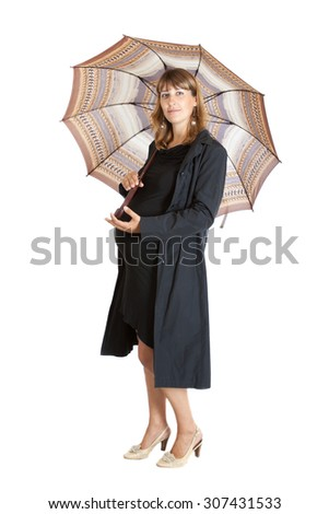 smiling pregnant woman (9 months) with a open umbrella, isolated on white background - stock photo