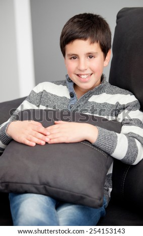 Smiling preteen on the sofa at home resting - stock photo