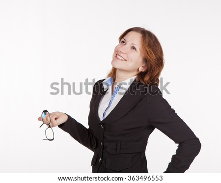 smiling pretty business woman in black suit holding a glasses and looking up closeup - stock photo