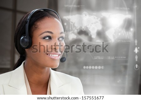 Smiling pretty businesswoman using futuristic interface hologram on dark background - stock photo