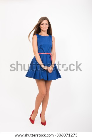 Smiling pretty girl in blue dress, studio full length portrait - stock photo