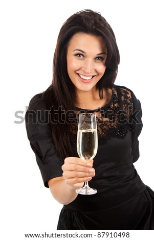 Smiling pretty woman standing holding a glass of champagne. Isolated over white background - stock photo