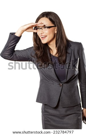 Smiling pretty young businesswoman looking into the distance - stock photo