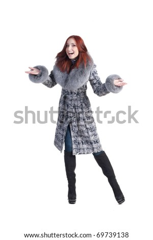 Smiling redhead woman in grey coat - stock photo
