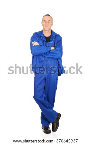 Smiling repairman with folded arms - stock photo