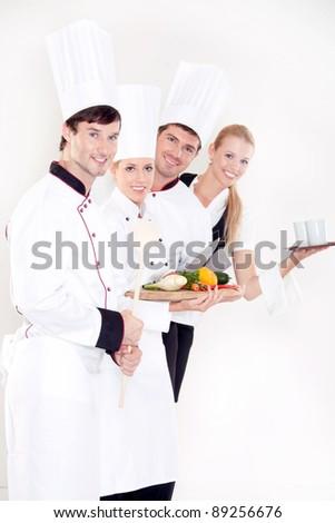 Smiling restaurant staff - stock photo
