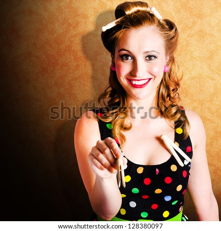 Smiling Retro Woman With Curly Brunette Pin Up Hair Style Doing Chores In Bathroom At Home When Hanging Up Washing With Pegs - stock photo