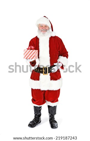 Smiling Santa Claus Holds Wrapped Christmas Present - stock photo