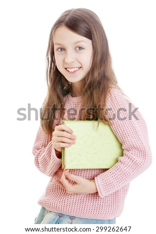 Smiling school age girl wearing a pink sweater holding under his arm a thick textbook, close-up-Isolated on white background - stock photo